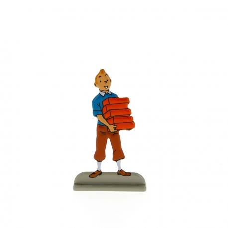 Tintin carrying books